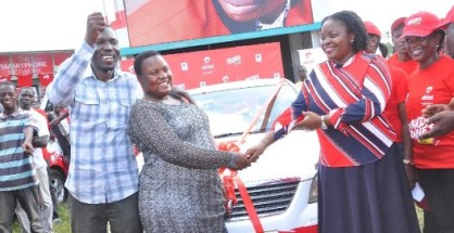 Rita Nabuzale being congratulated by Airtel's Remmie Kisakye,Head  of Brand and Communications  on her win of a brand new car