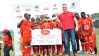 Airtel Uganda Managing Director, Anwar Soussa, hands over the trophy and a dummy cheque of Ugx 1,000,000 to Uganda Martyrs Girls ARS 2016 winners, Central Region