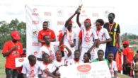 friends-of-soccer-players-celebraing-after-receving-their-tropy-as-the-winnners-of-ars-kitara-region