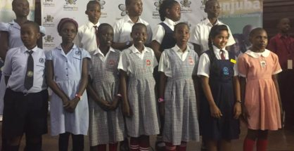 Pupils of Victorious Primary School, Hillside Primary School, Daffodils and City Parents primary school pose for a photo after winning the competition at KCCA, on October 8.
