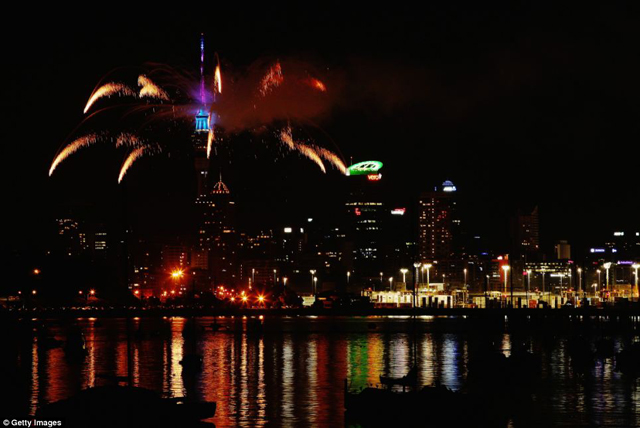 As midnight struck in New Zealand a fireworks display erupted over the city as thousands danced in the streets below.jpg