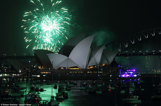 In Sydney hundreds of boats gathered in the harbour as bright firework displays began in the build up to midnight.jpg
