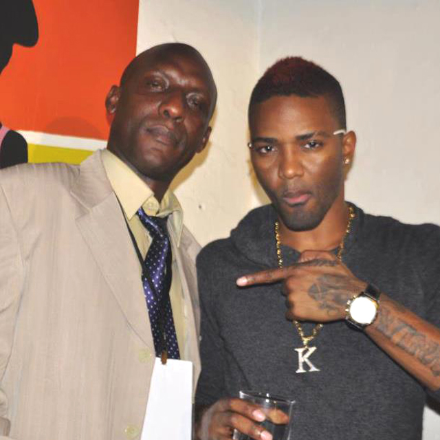 Okello (L) with Jamaican singer Konshens
