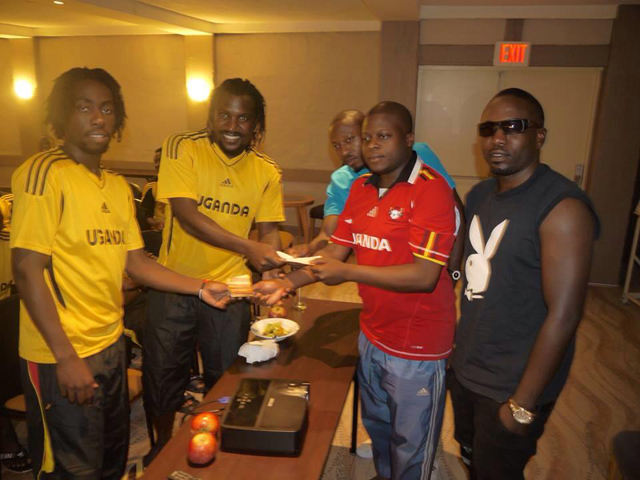Ivan, King Lawrence and Cheune handing over cash and cheque to Uganda Cranes players