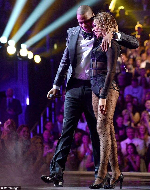 Jay Z and Beyonce hug as they finish their sexually-charged performance on stage