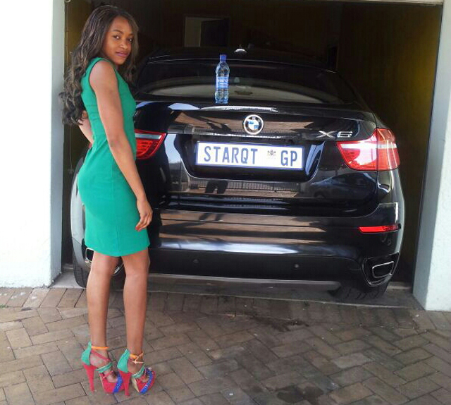 Stella Nankya posing on her BMW X6