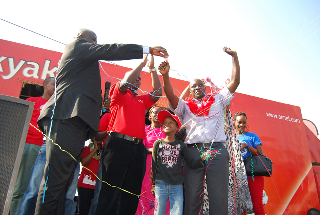 Amooti receives car keys after he was declared winner of Airtel's 7th Toyota Harrier