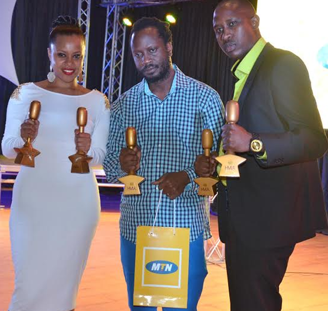 Bebe Cool (C) was the biggest winner of the night with six gongs