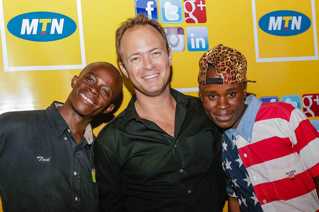 Ernst Fonternel (C), MTN's Chief Marketing Officer pose with guests