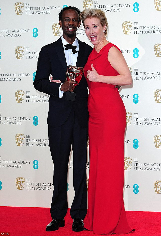 Extremely pleased; Barkhad Abdi looked extremely please with the Best supporting actor award for Captain Phillips, alongside Emma Thompson