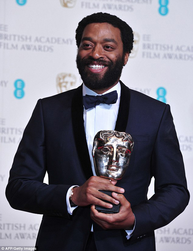Grinning from ear to ear; Chiwetel Ejiofor poses with his award for Best Actor for his work on the film 12 Years a Slave