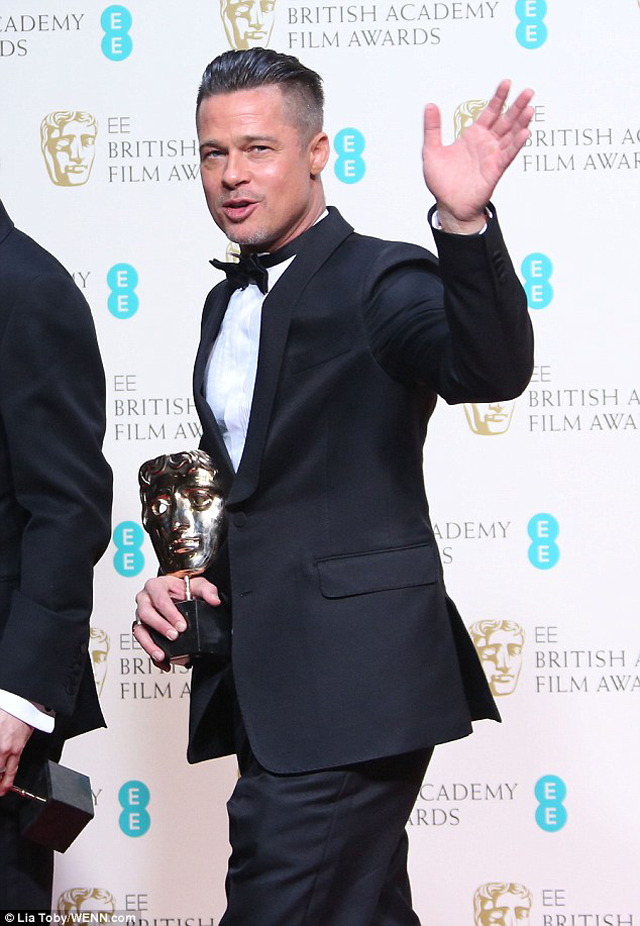 Satisfied; Brad Pitt looks happy to be walking away with Best Film for 12 Years A Slave