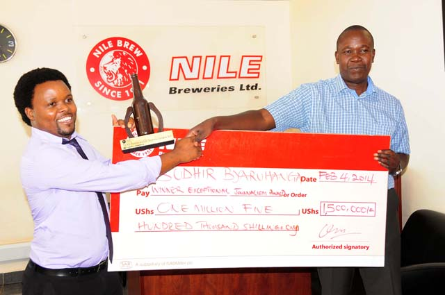 Sudhir Byaruhanga NTV Reporter (L) was named winner in the just concluded Nile Breweries Exceptional Journalism Awards