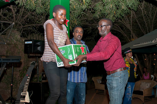 Suprise poet of the night Emily Tasha receives a box of Heineken from Morgan Boss