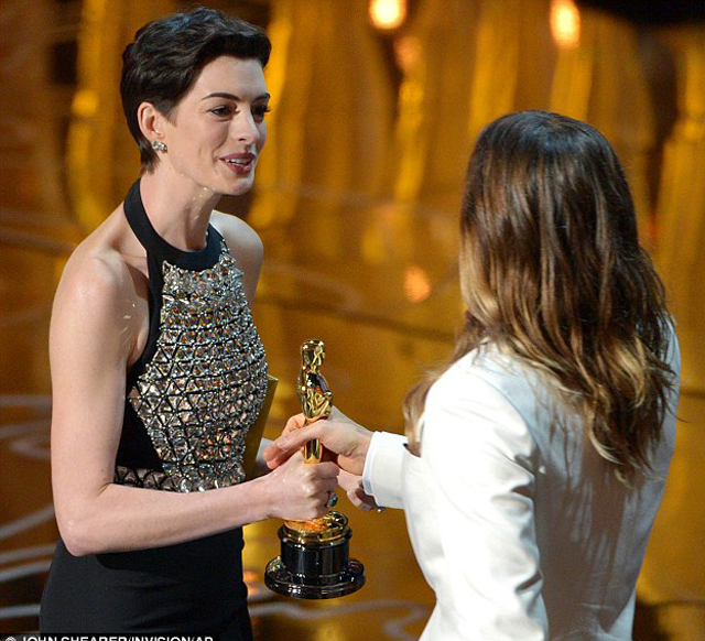 Anne Hathaway presented the best supporting actor Oscar to Jared Leto for his performance as a transgender HIV sufferer in Dallas Buyers Club