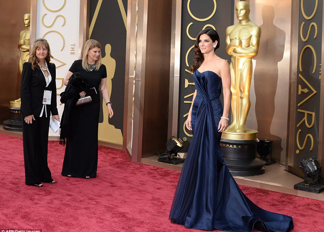 Sandra Bullock arrived in a navy blue Alexander McQueen gown, hoping to scoop her second Best Actress Osca