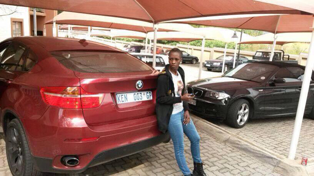 Cindy posing on Kenny's BMW X6 in South Africa