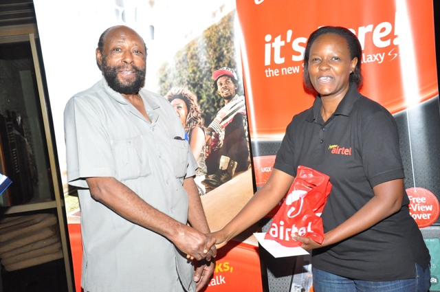 Mrs. Flavia Lwanga awards one of the people that have been influential in the growth of ladies' golf in Uganda