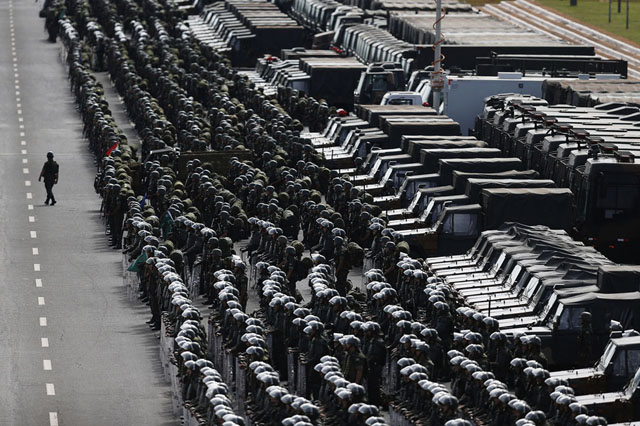Members of the Brazilian Army, Navy and Air Force attend a presentation of defense and security personnel and equipment that will be used during the 2014 World Cup in Brasilia