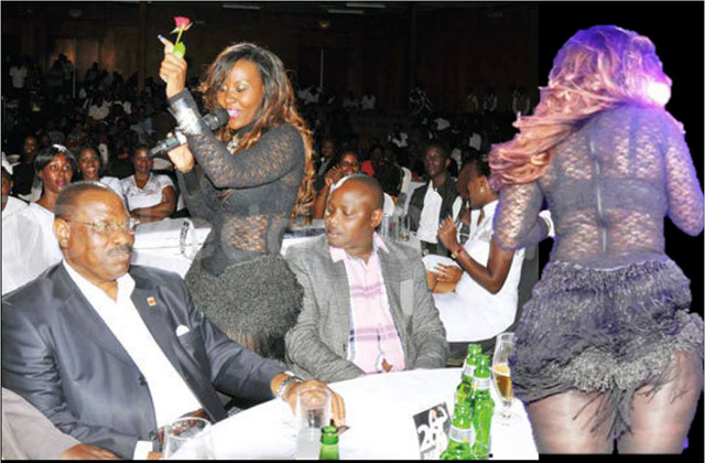 Minister Kibuule couldn't keep his eyes off singer Desire Luzinda's butt