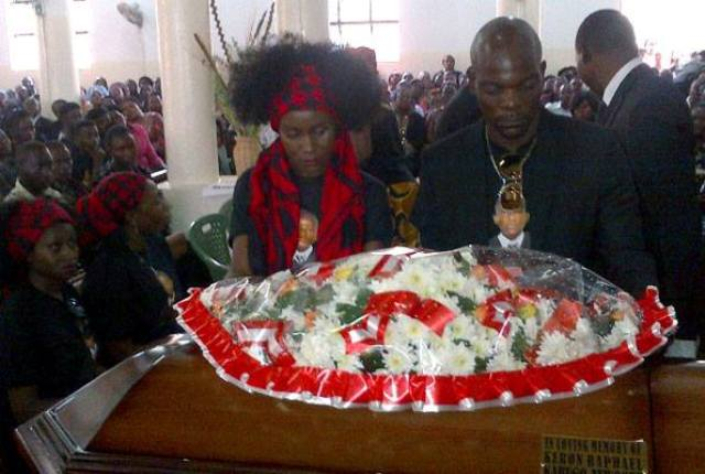 Juliana Kanyomozi and Amon Lukwago lay a wreath at the coffin containing the remains of the son Keron