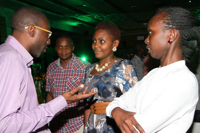 UBL Marketing Manager Themba Nobanda(L)interacts with representatives from the Chartered Institute of Marketing