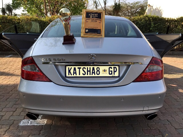 Katsha put his award on his CLS 500 Benz