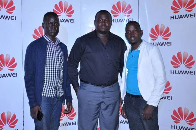 Organiser, Simon Sipate (R) with officials from Huawei Uganda