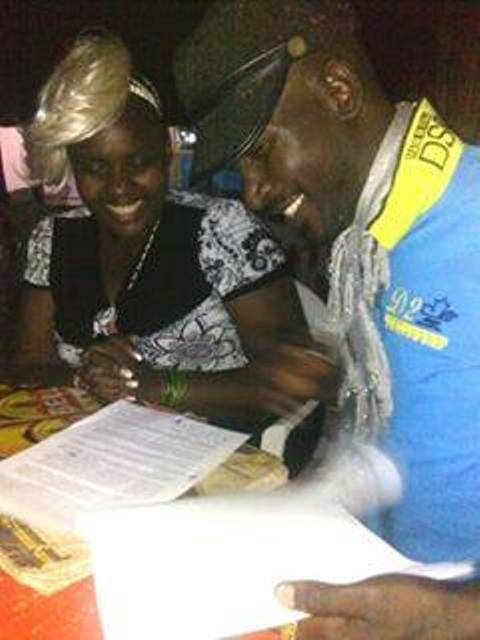 Straka looks on with a smile as Qute Kaye signs for her management