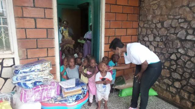 Desire Luzinda sharing with the kids at Ibanda Babies Home after delivering her promise last month