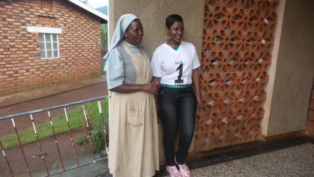 Desire Luzinda with one of the caretakers of Ibanda Babies Home