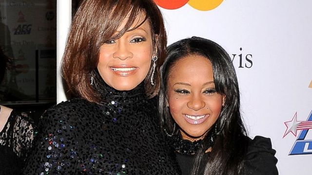 Bobbi Kristina Brown (R) with her late mum Whitney Houston