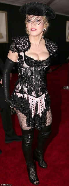 Ole to the queen; Madonna, 56, showed up in a matador-inspired outfit in black by Givenchy at the 2015 Grammy Awards in LA on Sunday