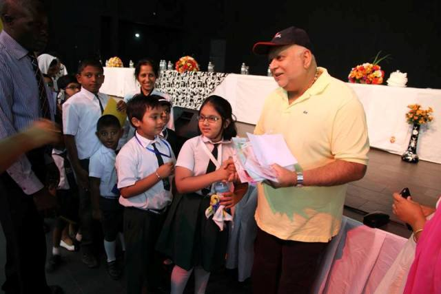 Sudhir Ruparelia with students of the school at official opening ceremony