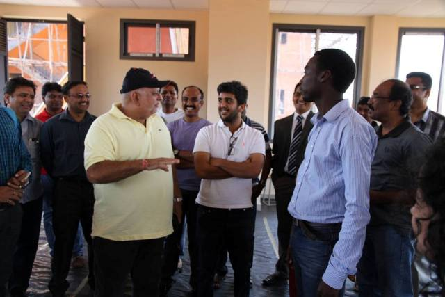Sudhir with son Rajiv and other officials at the school complex