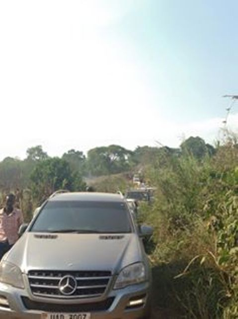 A Line up of cars heading for the burial of AK47