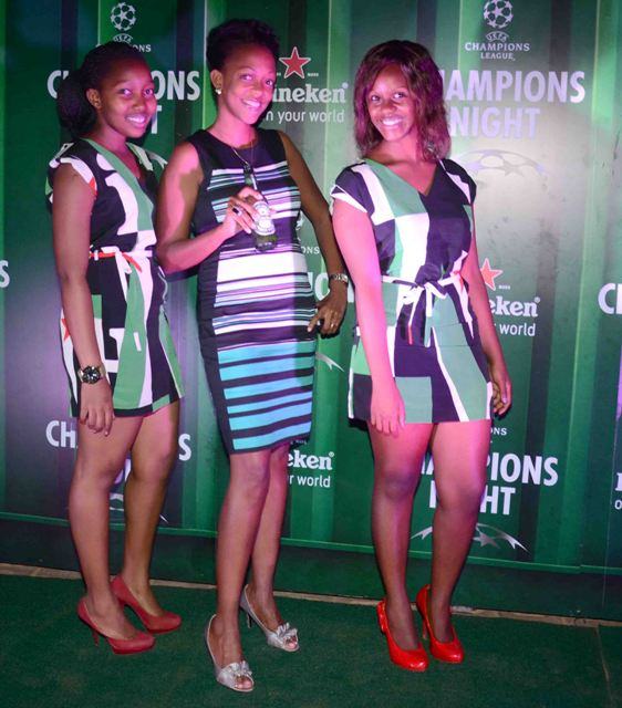 Country Manager Heineken Uganda, Julian Kagwa with Heineken ushers at Trendz Bar on Tuesday 'Champion The Match' launch