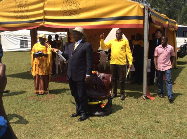 Frank Tumwebaze (in yellow shirt) with his boss President Yoweri Museveni in Kamwenge in February 2015