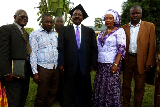 Hajji Mbabaali joined by his wife and other friends after his graduation