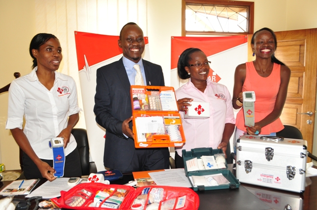 Trevor Ariho the acting MD AAR and team displaying the kits