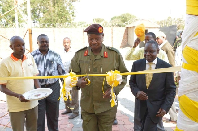Omach (R) with President Yoweri Museveni at the opening of his FM station in Nebbi district