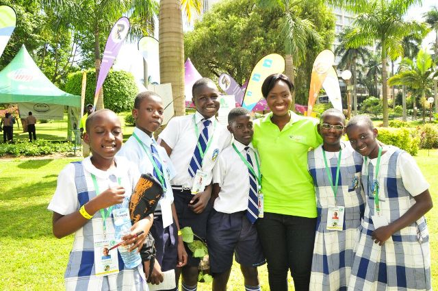 A member of Little Hands Go Green pose for a photo with some of the children at the conference