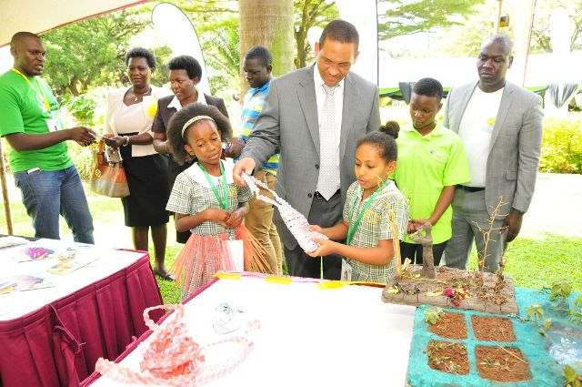 Mirembe Junior School children explaining what saving environment does, to Vivo MD Hans Paulsen