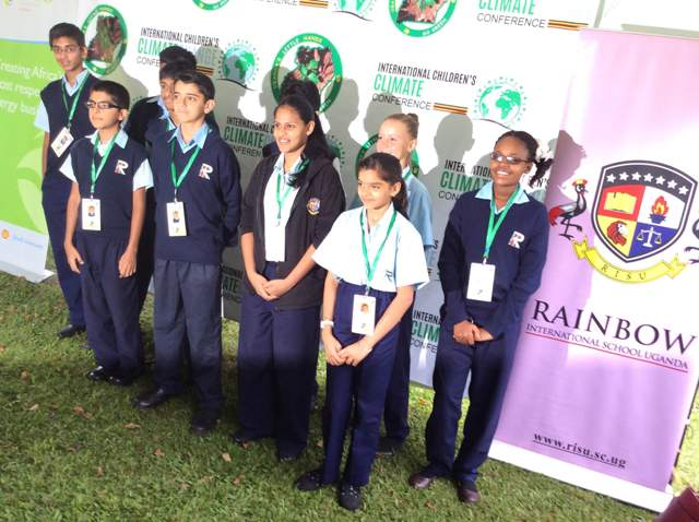 Rainbow International school children pose for a group photo after arriving for the conference