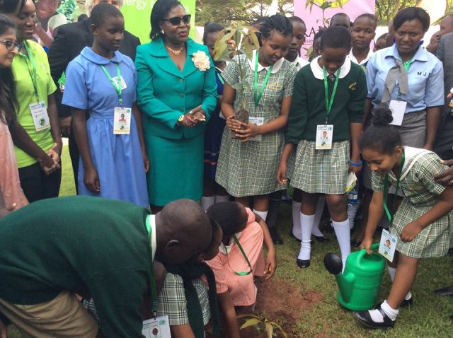 Ruth Nankabirwa prepare to plant a tree with Little Hands Go Green kids