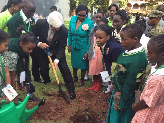 Kampala Sheraton Hotel general manager, Ian Duncan joins Ruth Nankabirwa to plant some tree