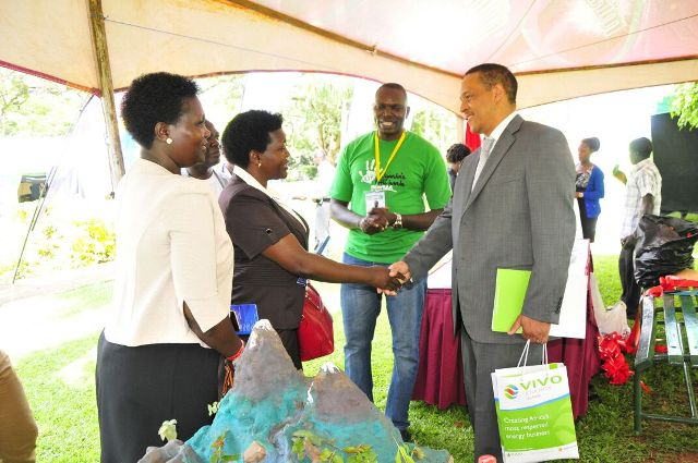 Vivo Energy MD Hans Paulsen greets some dignitaries at the conference as Little Hands Go Green CEO Joseph Masembe looks on
