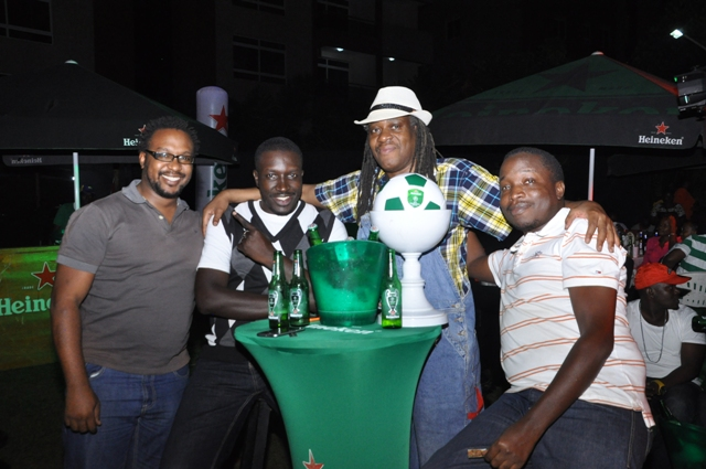 NTV Uganda Men's Collins Asiimwe, Capital FM's Val Oketcho, Alex Ndaula pose with a friend at the launch