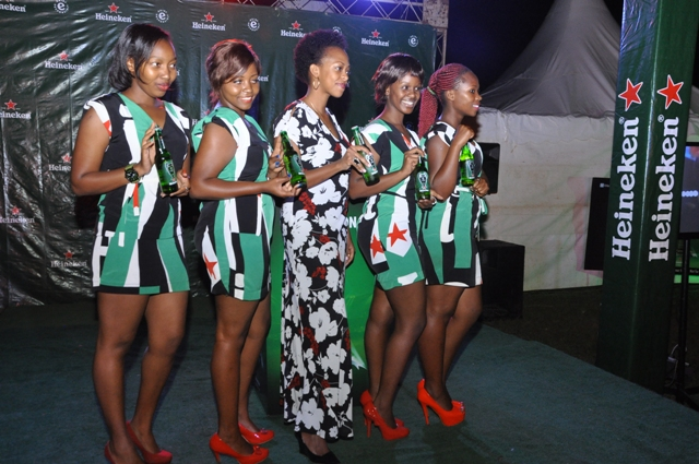 Heineken Uganda Country Manager, Julian Kagwa (C) pose with the ushers of the night at the launch