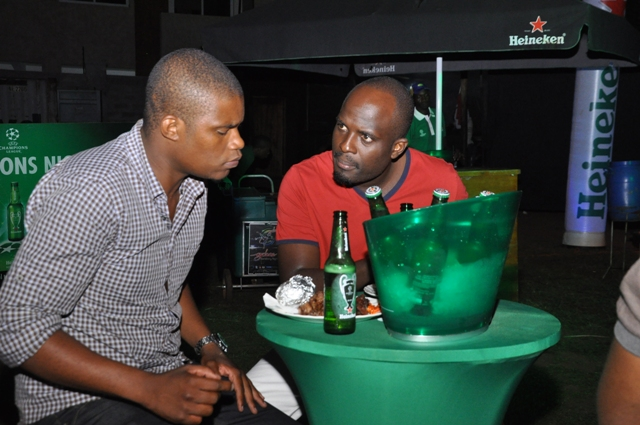 Andrew Kabura and NTV's Joel Khamadi at the Heineken bottle launch on Friday at Kololo Gardens